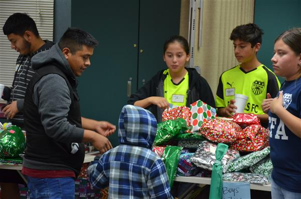 Soccer players giving out gifts