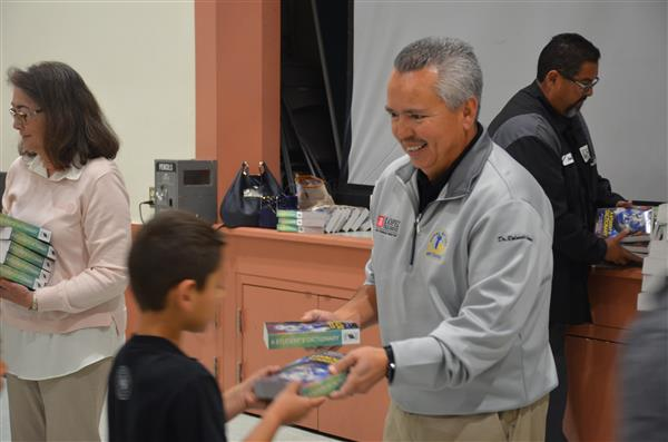 Ralph Martinez delivering dictionaries