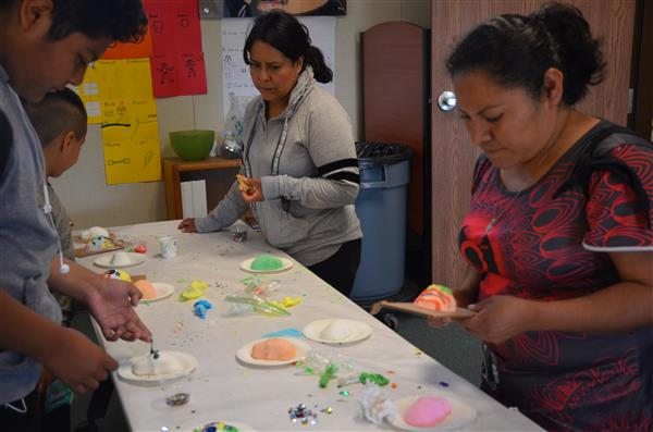 families making sugar skulls