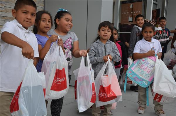 Children showing their shopping bags