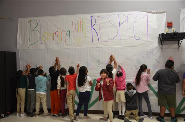 Children sign wall of respect