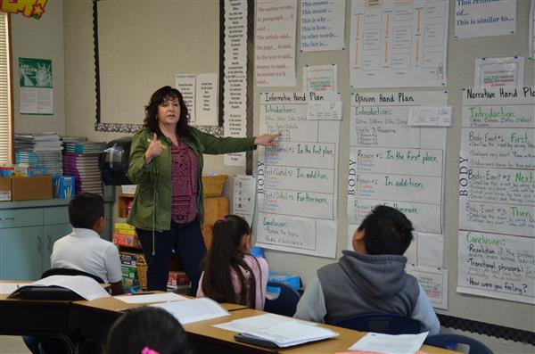 Norma Garcia in front of her classroom