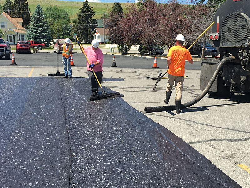 workers applying slurry seal